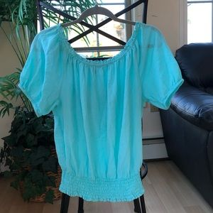 Michael Kors Off the shoulder turquoise top.